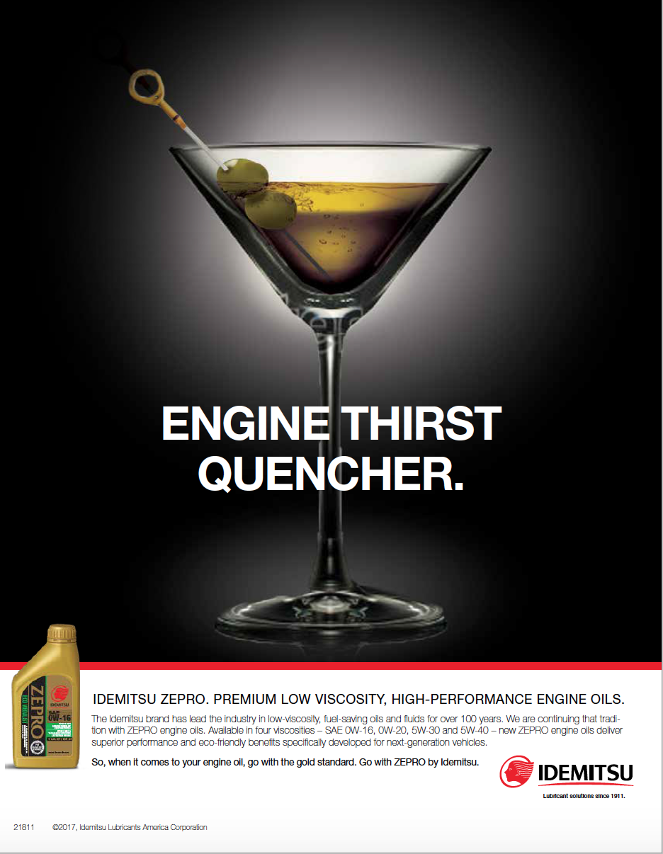 Print ad of a martini glass filled with oil and olives skewered onto a dipstick with text above that says engine thirst quencher