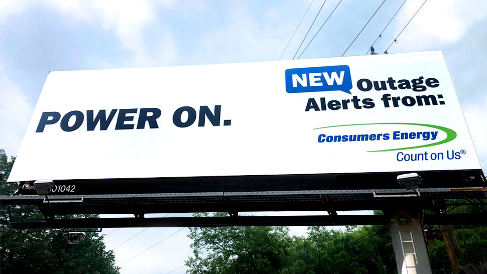 Consumers Energy billboard design that says Power on. New outage alerts from consumers energy