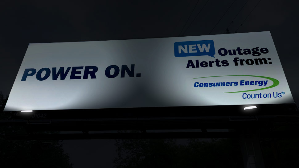 The same Consumers Energy billboard design but at night.