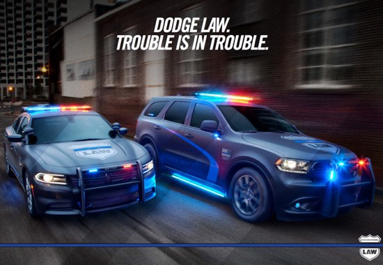 A Dodge Pursuit poster with a Dodge Charger and Dodge Durango speeding down the street that says, Dodge law. Trouble is in trouble.