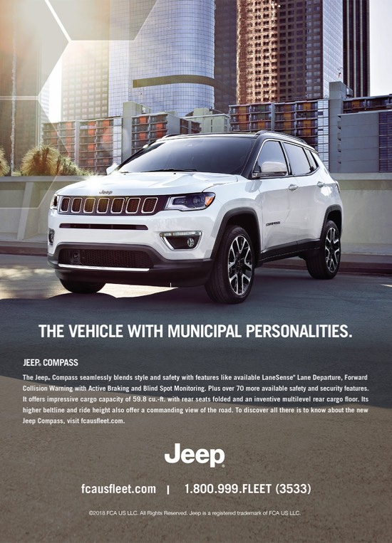 Jeep poster showing a white Jeep compass in a city that says the vehicle with municiple personalities