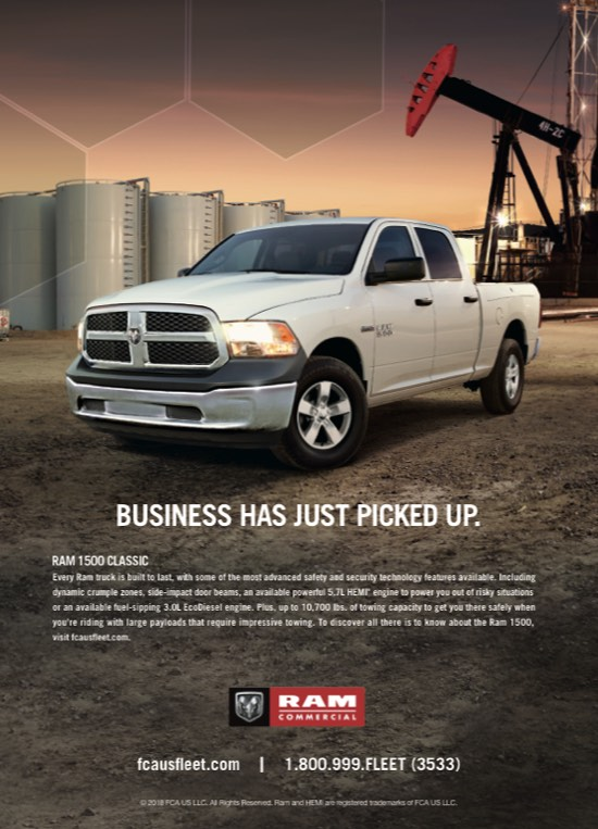 Ram poster showing a white Ram truck in an industrial area that says business just picked up
