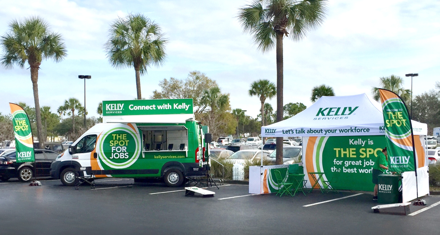 Kelly services pop up van and tent in a parking lot