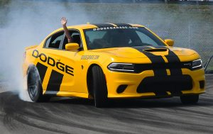 Dodge car with smoke behind it